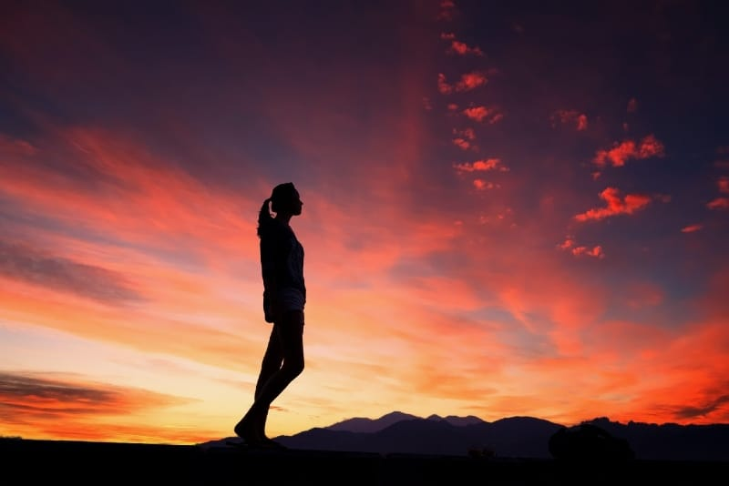 woman standing outdoor during sunset