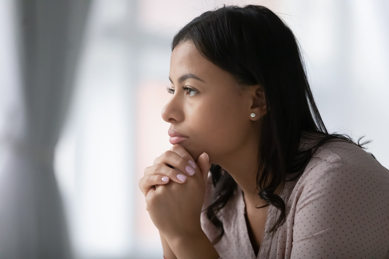young woman look in distance pondering