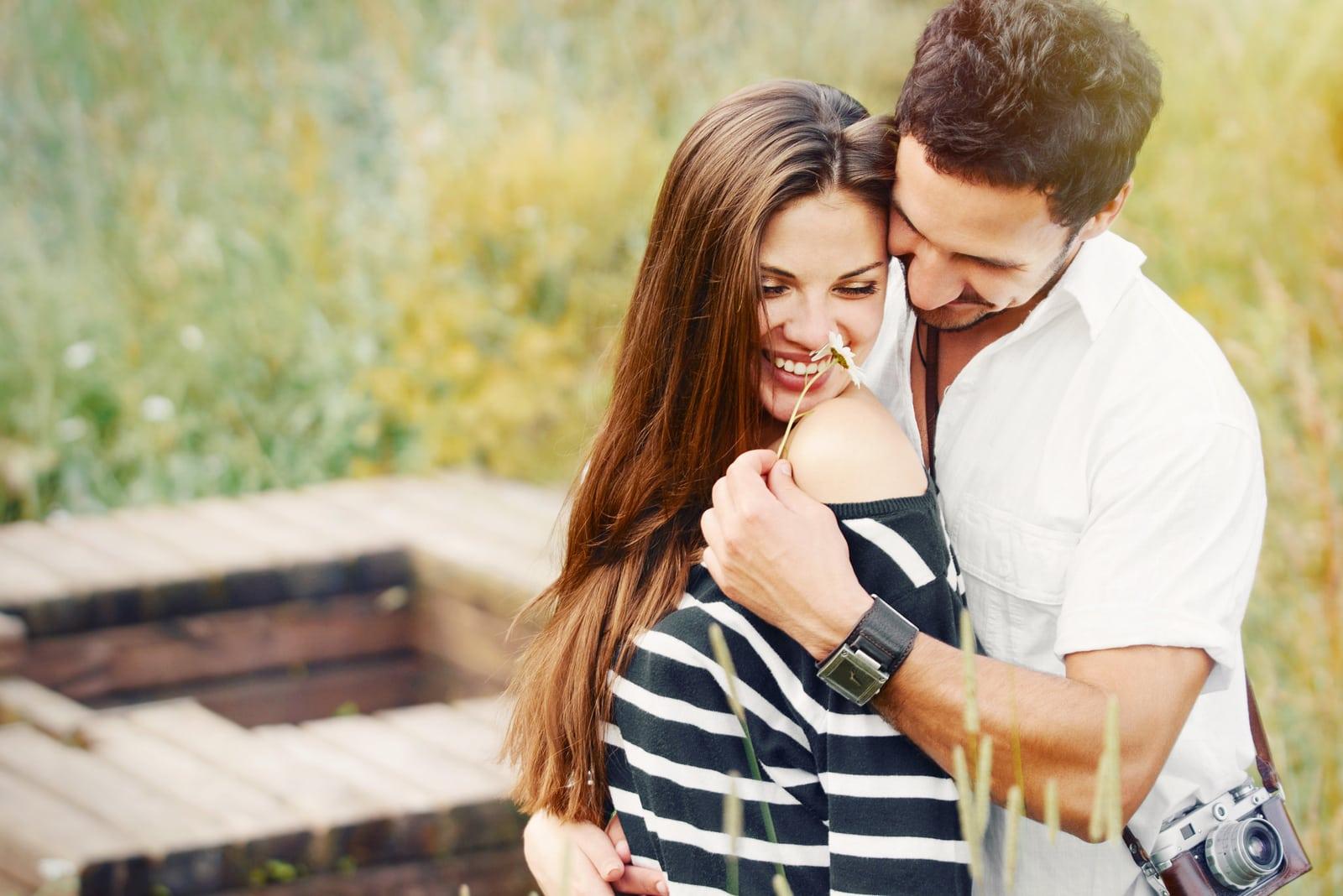 a happy romantic couple hugging