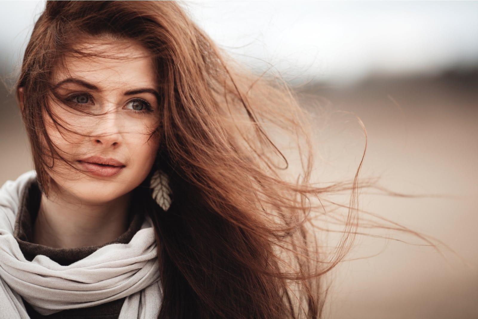 beautiful girl in nature windy hair