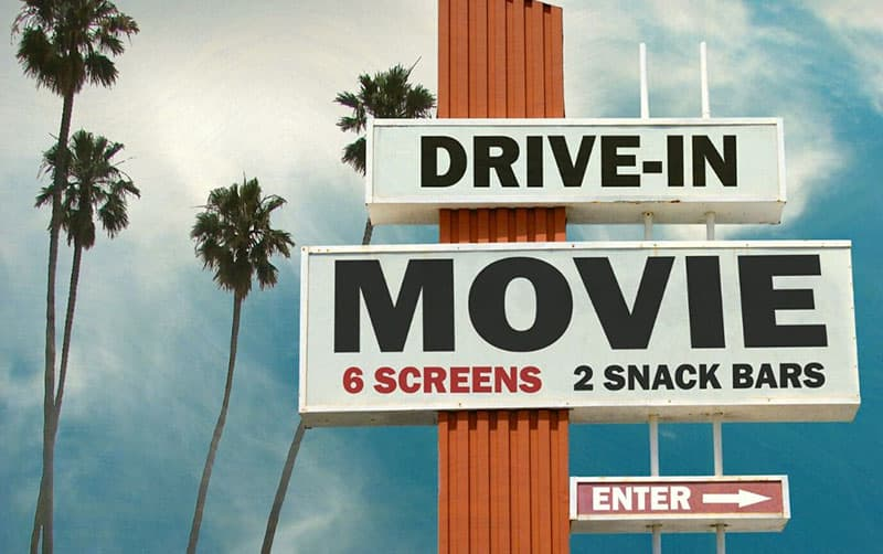 drive in movie and snack bar sign