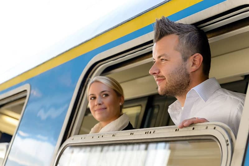 man and woman inside a public vehicle woman staring at the man looking outside the windows