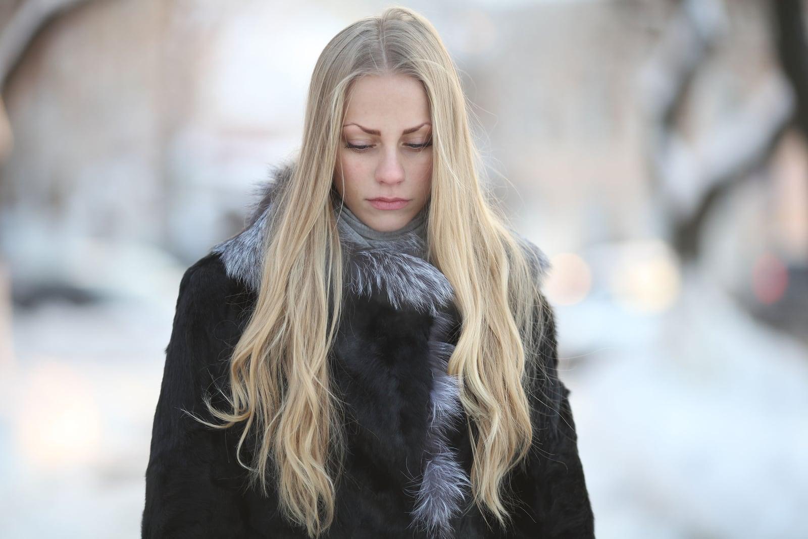 sad beautiful girl, with long blond hair