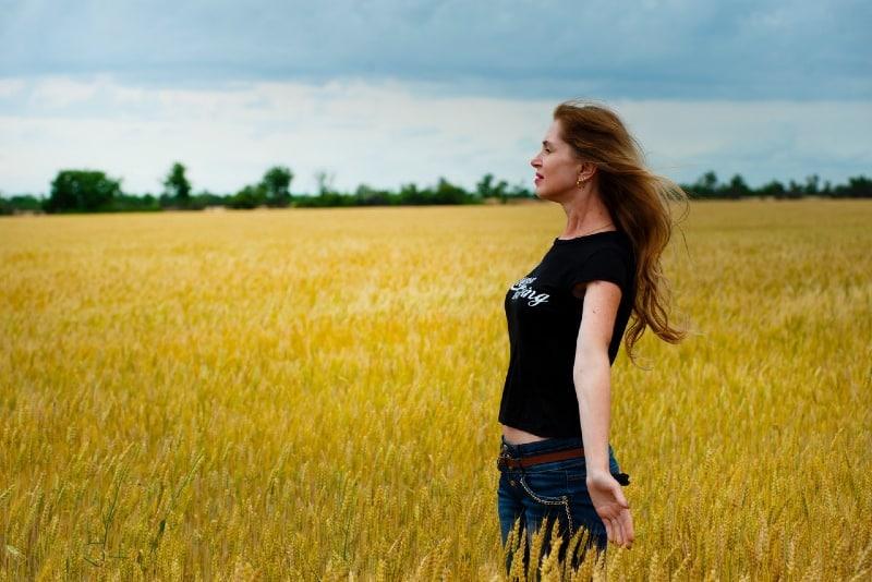 woman in black shirt standing in field