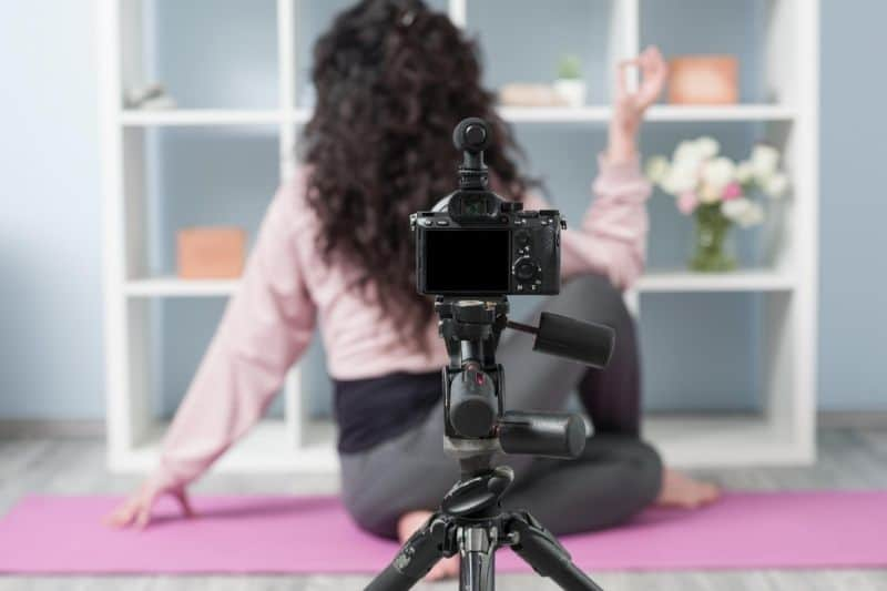 adult influencer teaching yoga on social media