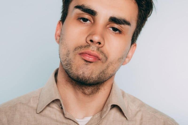 arrogant man's face in focus showing defiance