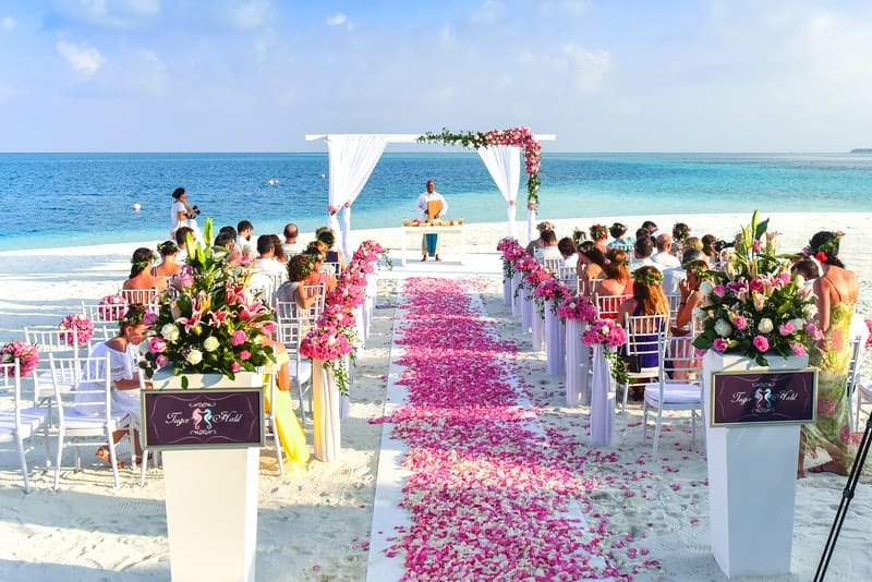 beach wedding ceremony during daytime with full of guests