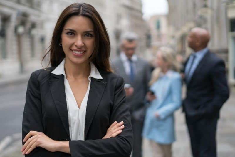 business woman leading a group standing outdoors