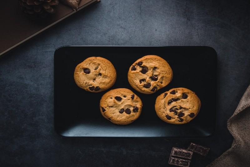 chocolate cookies on black plate