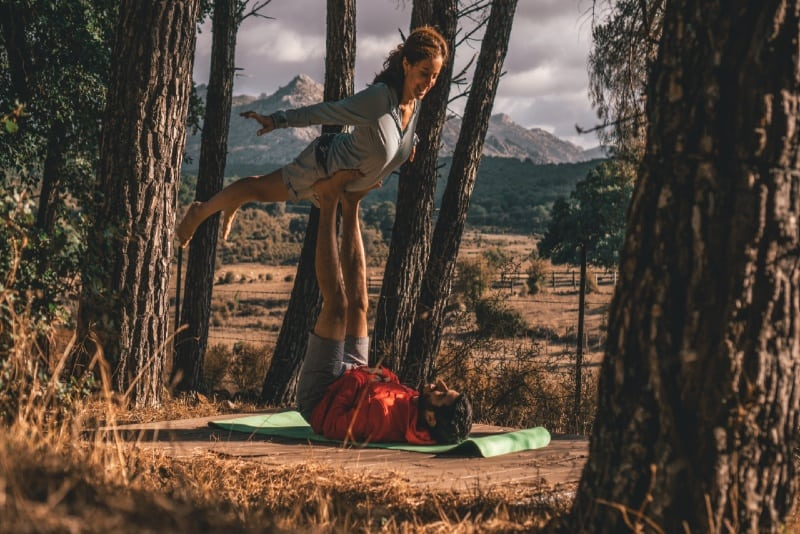 man and woman doing yoga outdoor