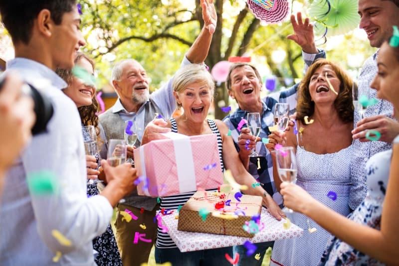 family having birthday party in garden