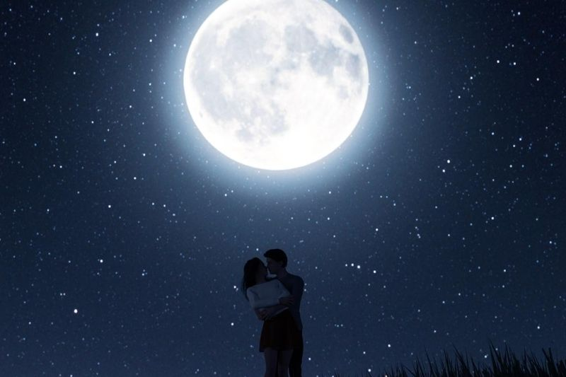 love couple under the moonlight and starry skies hugging