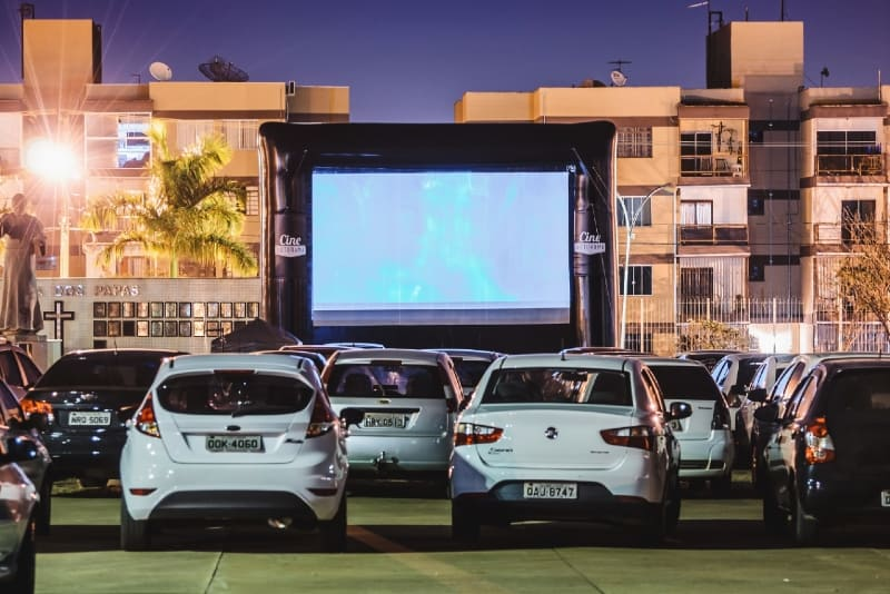 people watching movie inside cars