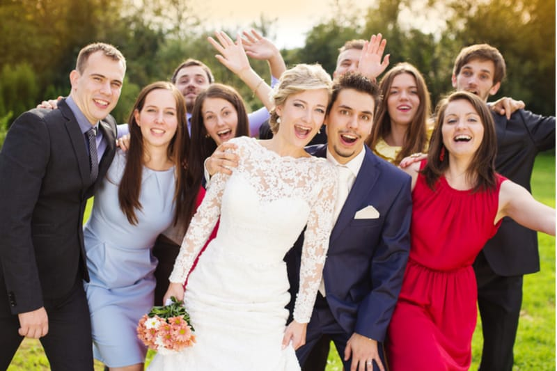 picture of a wedding couple and friends posing with happiness