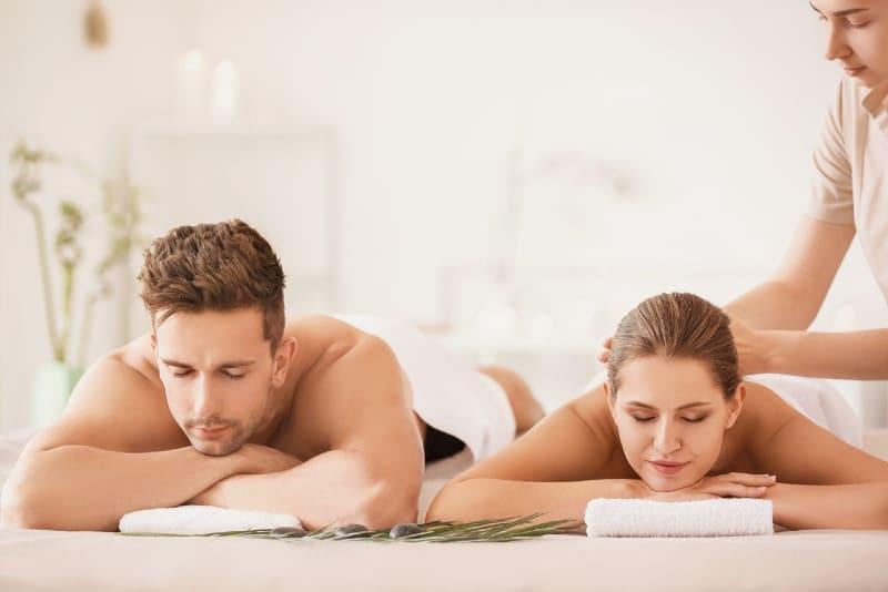 woman having massage while lying near man