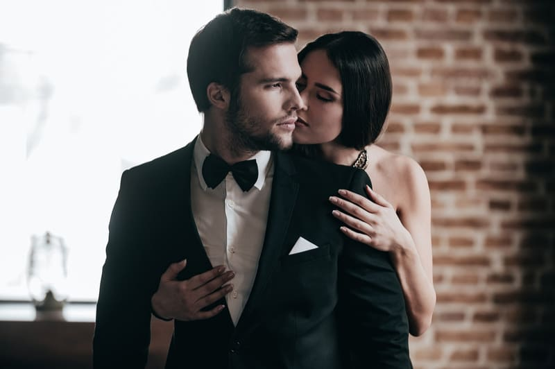 woman showing love to the man dressed formally