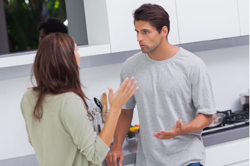 young couple arguing inside the kitchen