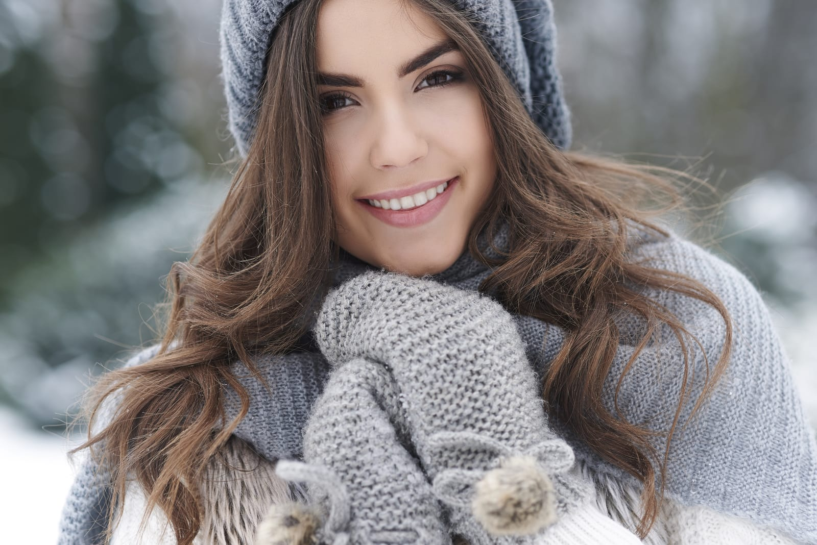 portrait of a beautiful brunette outside in winter
