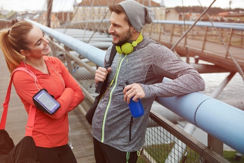 after workout conversation between couple on athletic wear outdoors