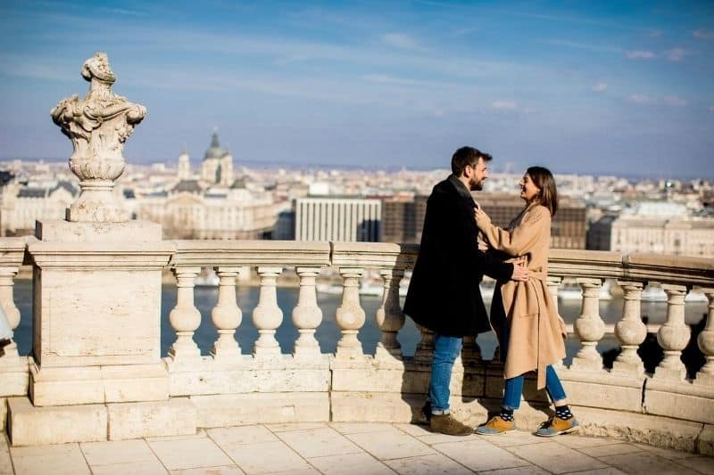 beautiful couple in love hugging at the background of magnificent view of Budapest