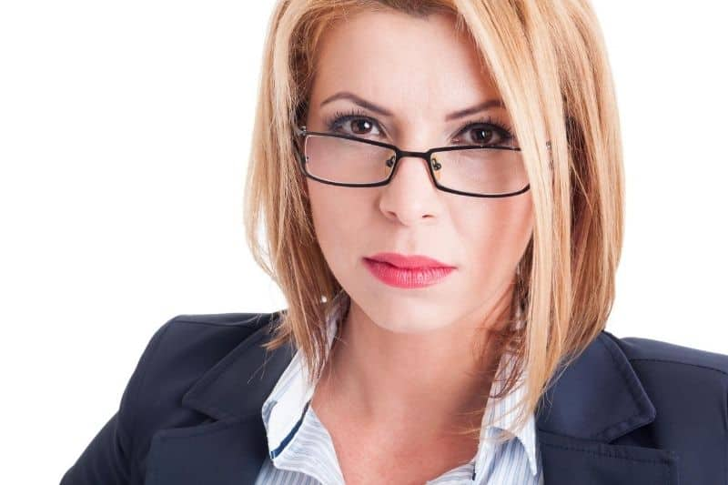bossy business woman wearing eyeglasses focus on the face