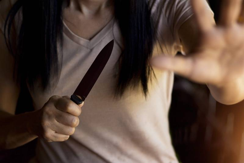 close up photo of woman holding a knife