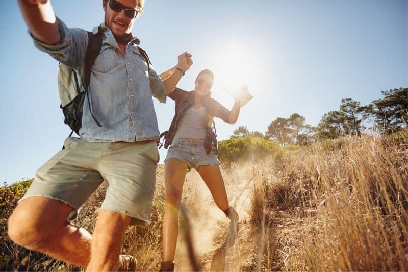 couple enjoying themselves during an adventure trek at mountain