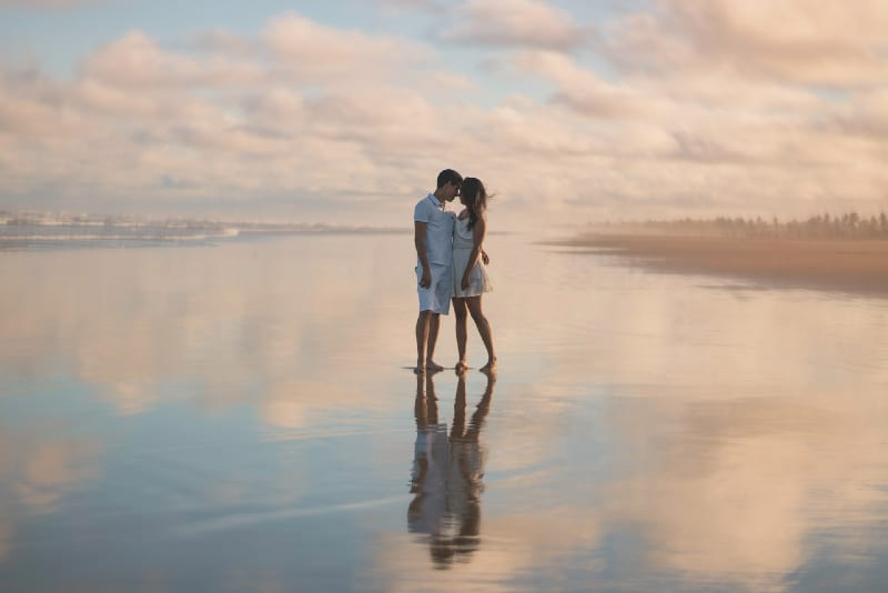 couple standing on water
