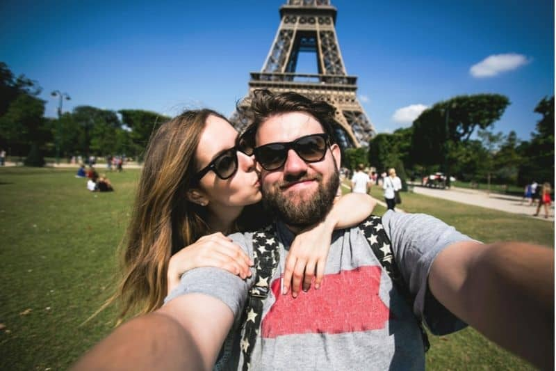 couple taking a picture of themselves at France Eiffel tower