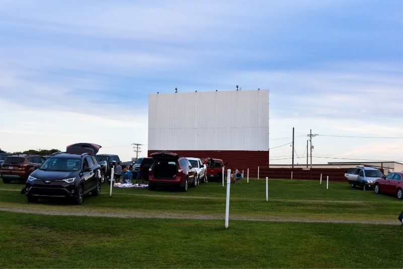 drive in cinema outdoors with cars filling up the field