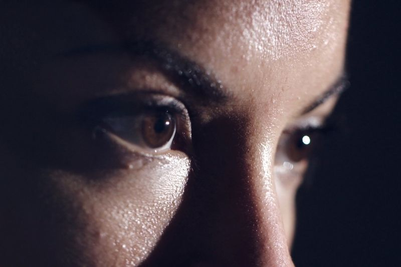 female athlete's eyes in focus heavily focused on her mission