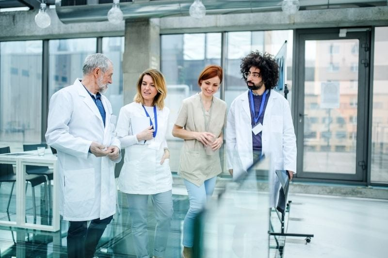 group of doctors talking in corridor of the hospital on conference