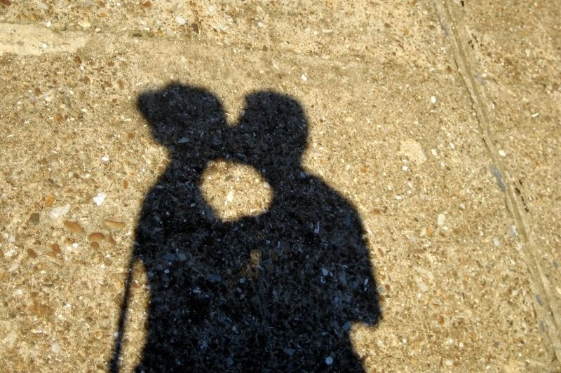 shadow of a couple kissing in the pedestrian street