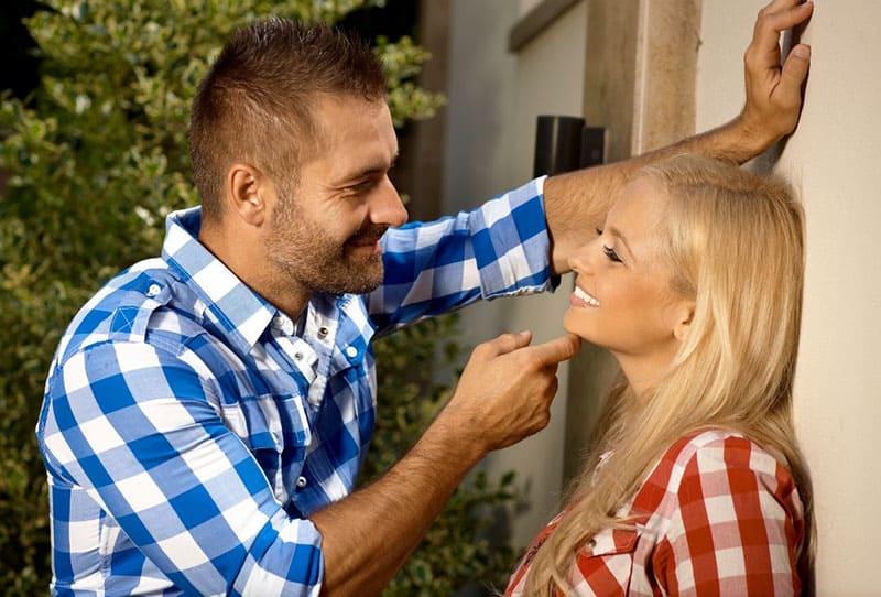 sweet couple wearing checkered top seeing eye to eye