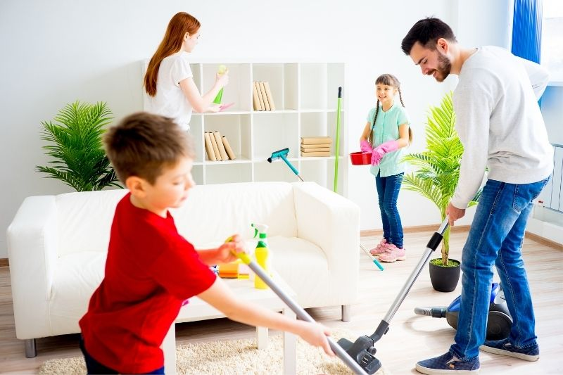 whole family cleaning the living room intensively