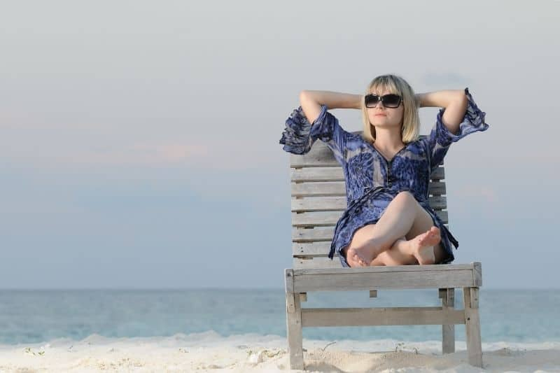 woman enjoys tranquility relaxing in the chair in the beach