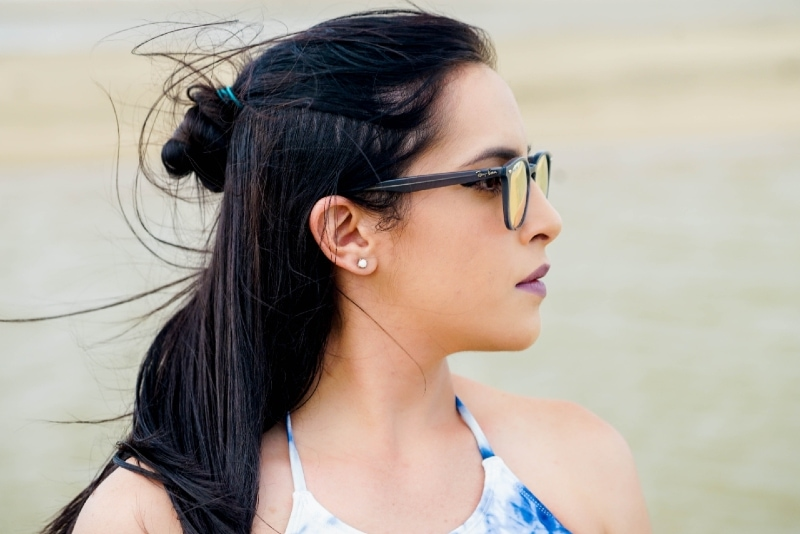 woman with eyeglasses looking to her left