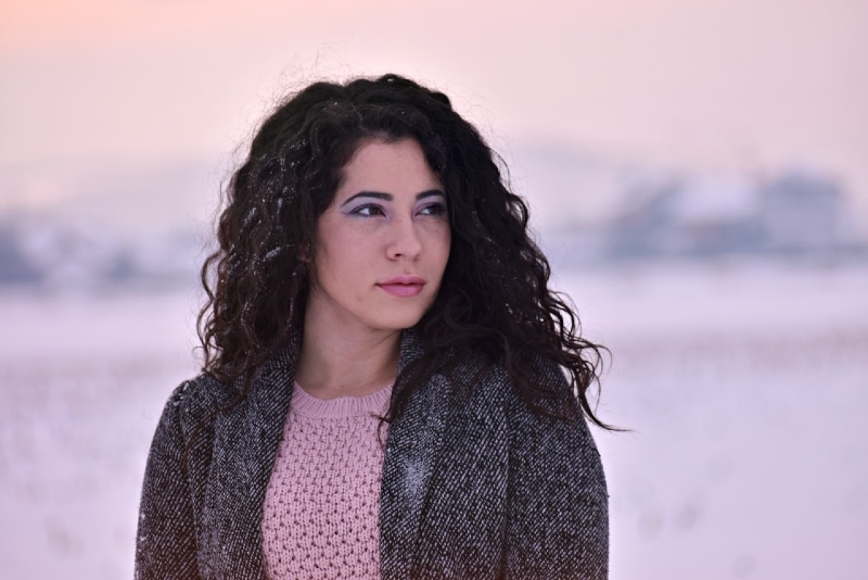 woman with curly hair standing outdoor