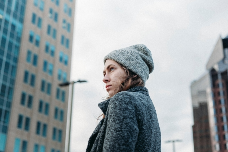 woman with gray knit cap standing outdoor