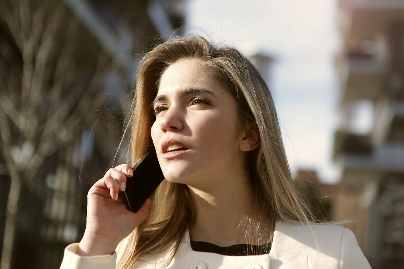 woman talking on the phone while standing outdoor