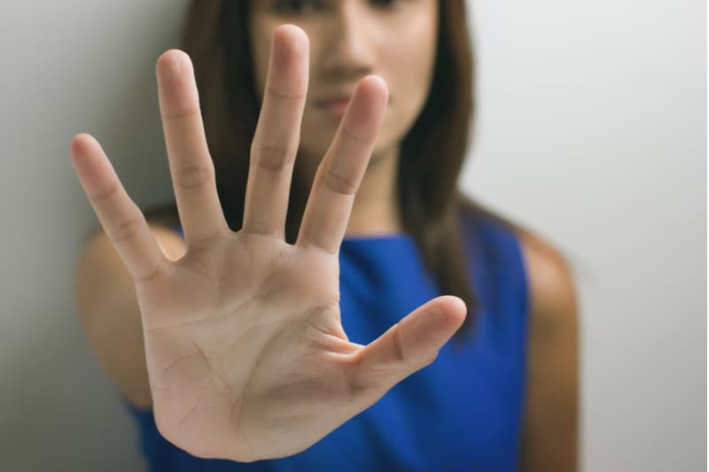 young woman showing her denial with her hand in focus