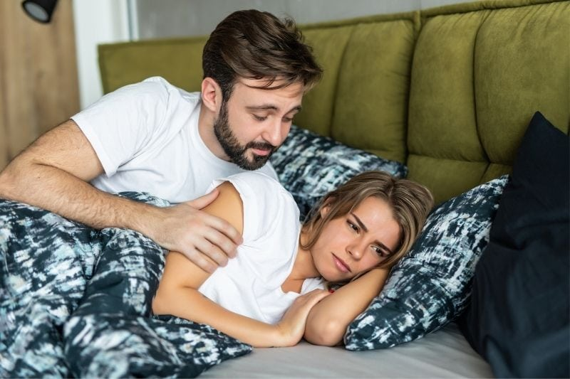 offended woman doesn't speak to his husband while lying in bed