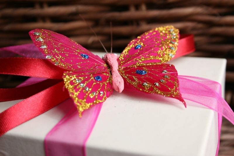 birthday gift with butterfly ribbon glittered with different colors
