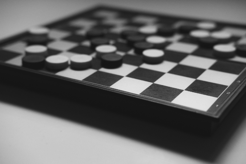 checkered board game on white table
