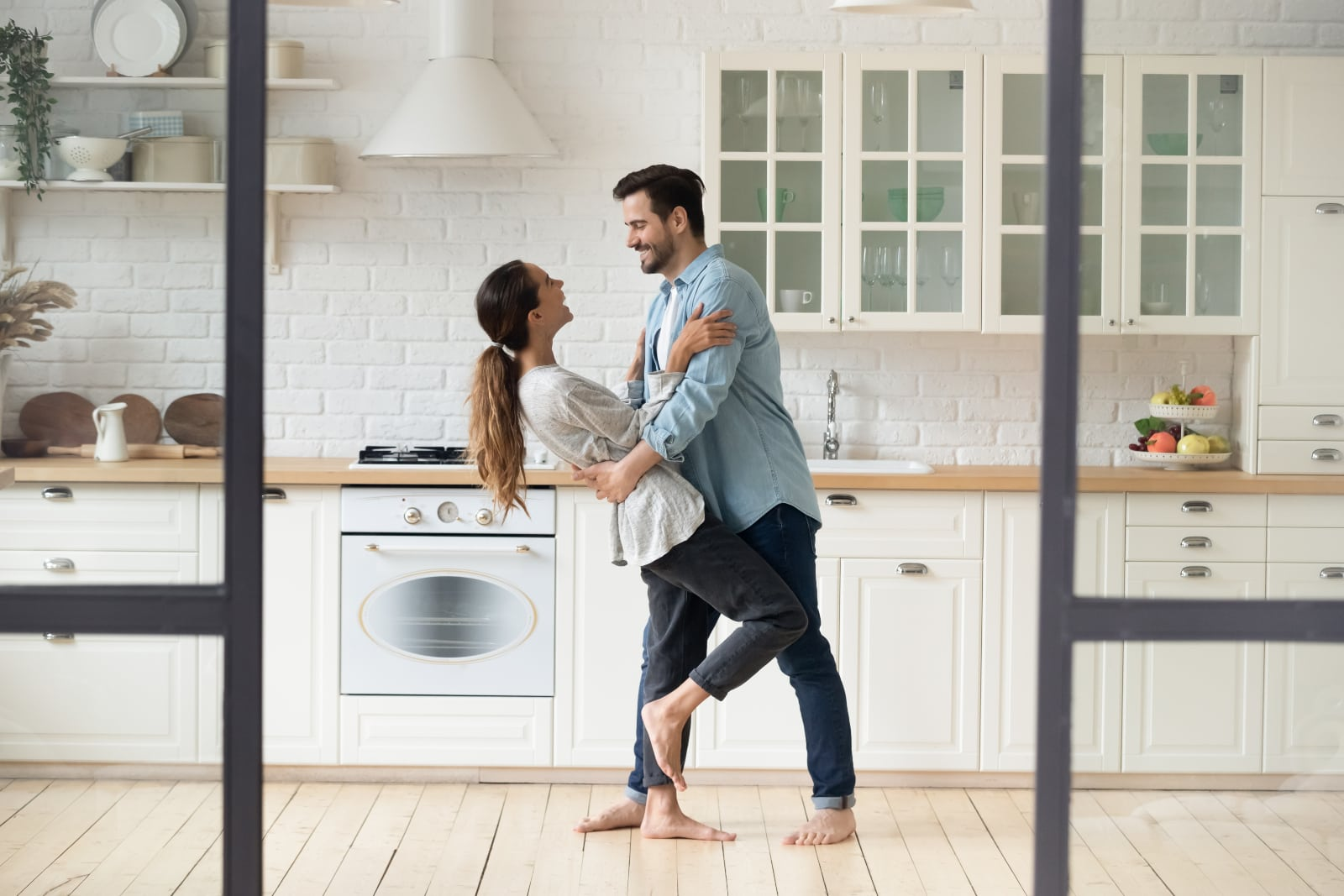 couple dance together in the kitchen