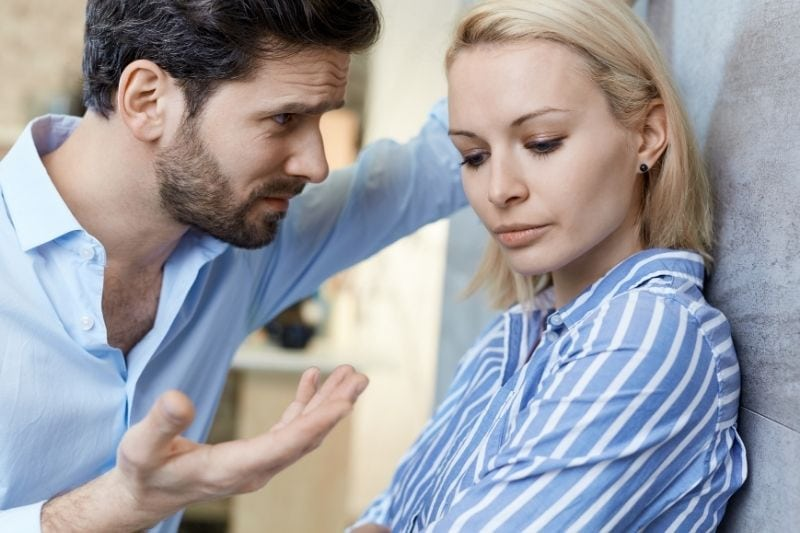 couple having relationship problems woman sulking and man talking