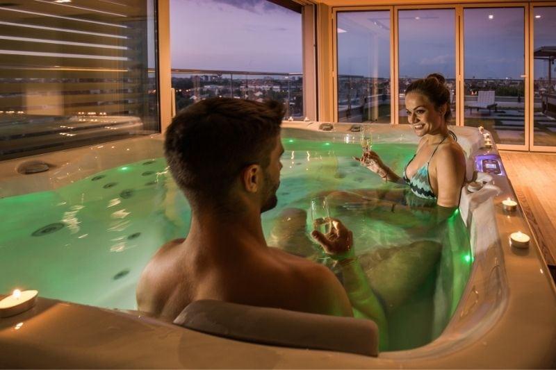 couple inside bathtub drinking wine inside the hotel