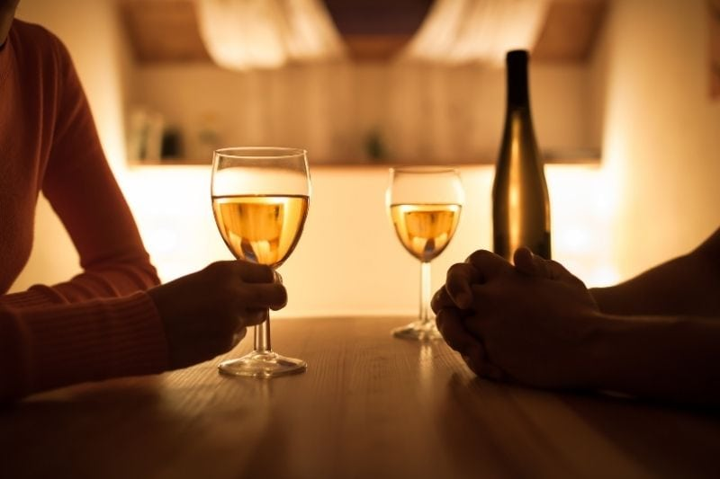 couple sitting together in dinner date with a wine