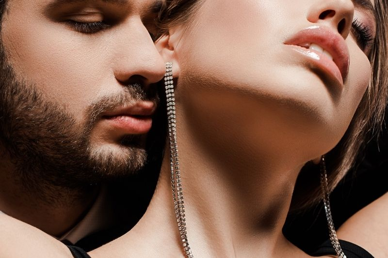 cropped image of a bearded man near a seductive woman