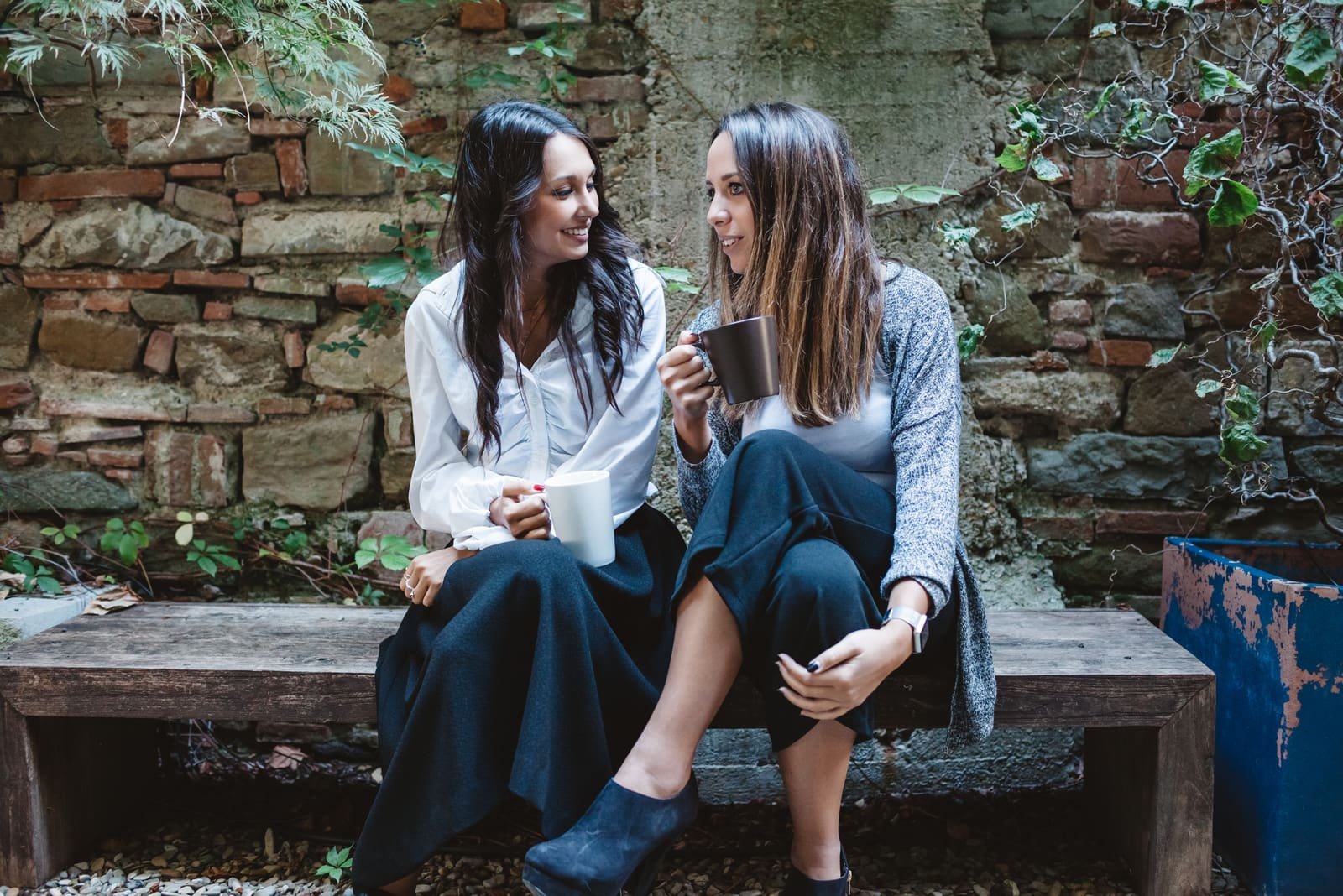 girlfriends talking and drinking coffee